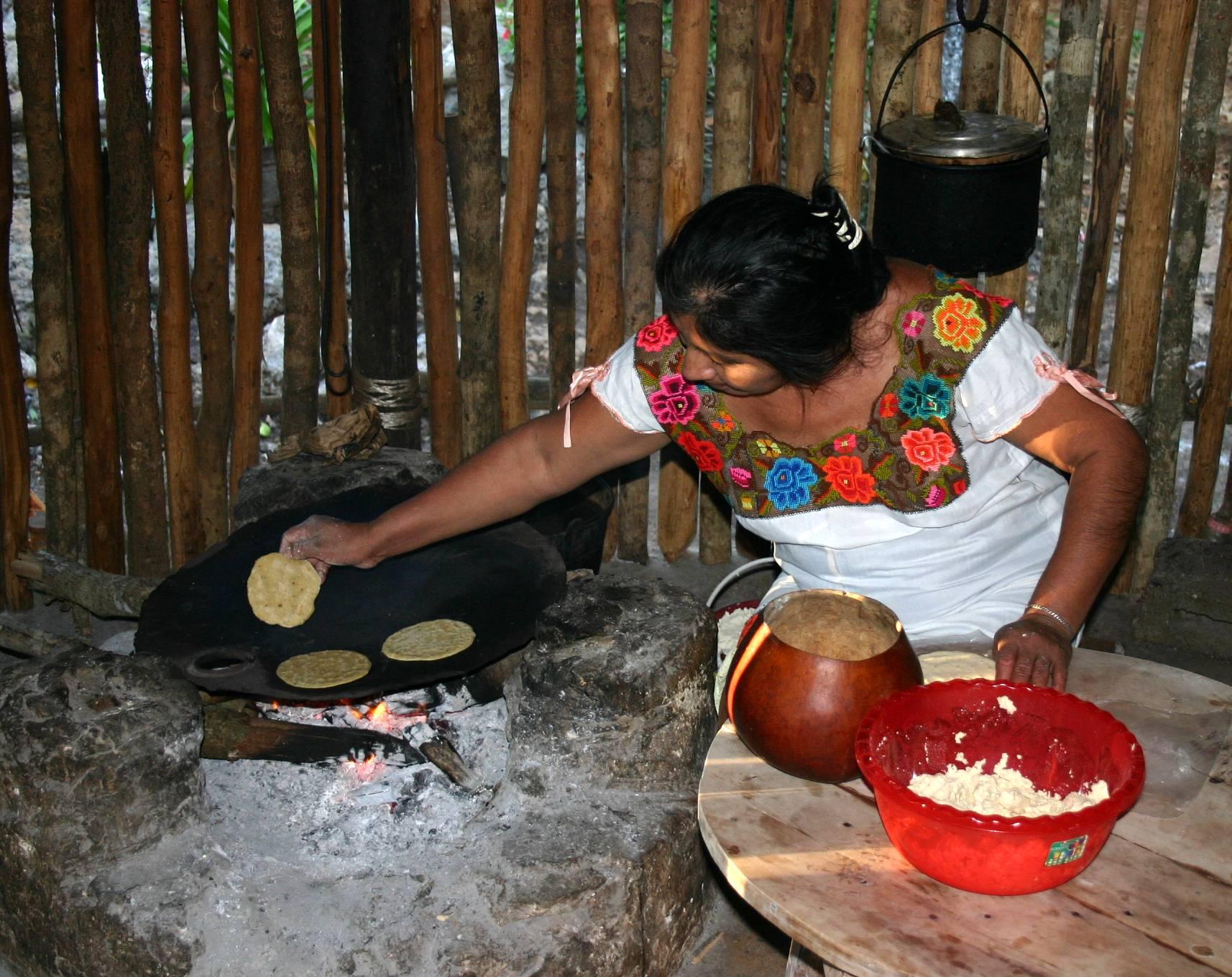 Mexican woman preparing tortillas