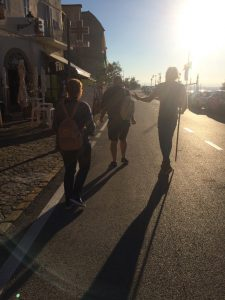 Walking in Loreto with the bastione pilgrim stick freshly blessed from a priest, Loreto, Marche