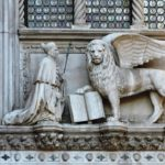 Venice - the Doge's Palace - the Dogs with the lion of St Mark above the portico that connects the palace to the basilica and leads to the entrance of the palace