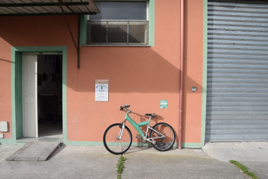 Samugheo - Mulino Sulis - the entrance to the mill and the owner's color-coordinated bicycle