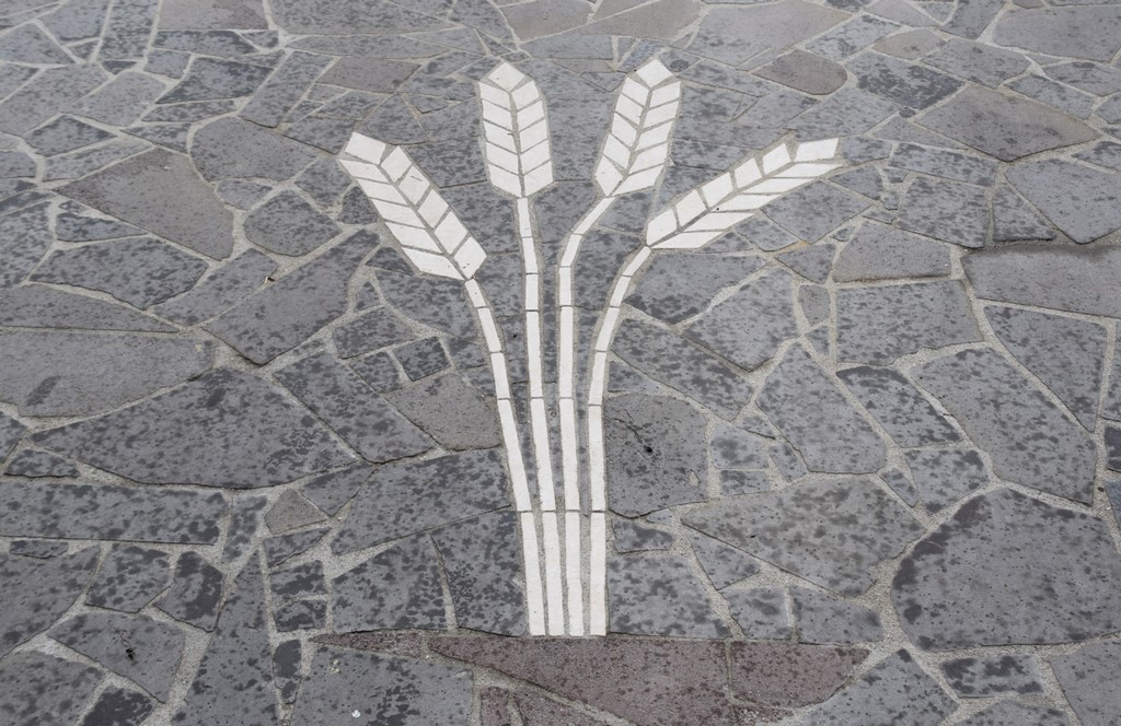 Samugheo - Shafts of wheat - the central theme of the stone mosaic entrance to Pane Nostu