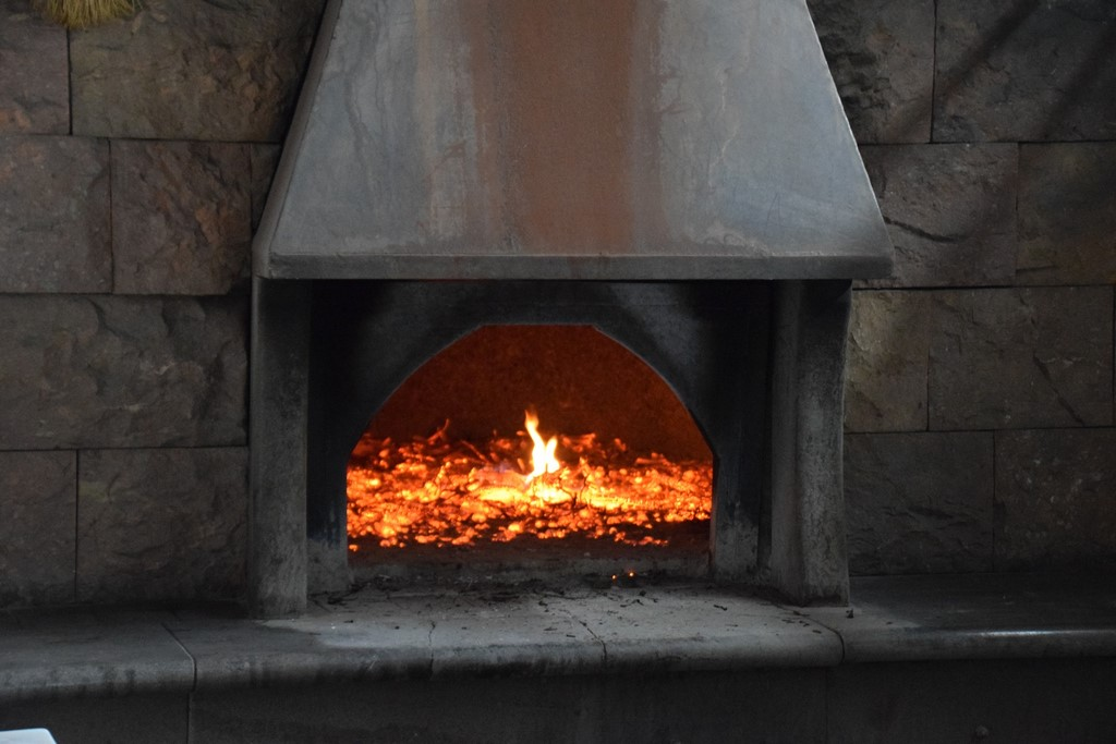 Samugheo - Pane Nostu - Antonello fills the oven with wood, sets it alight, and then waits as the burning wood reduces to hot coals
